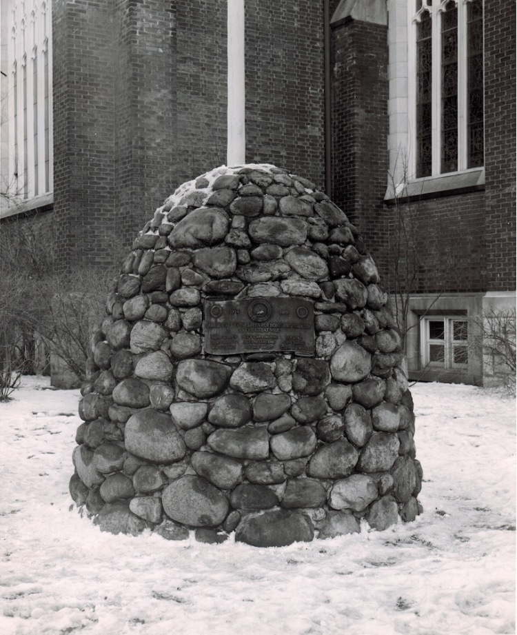 St. Giles' War Memorial Cairn in 1957; it sits on the snowy lawn, in a black & white photo from 1957